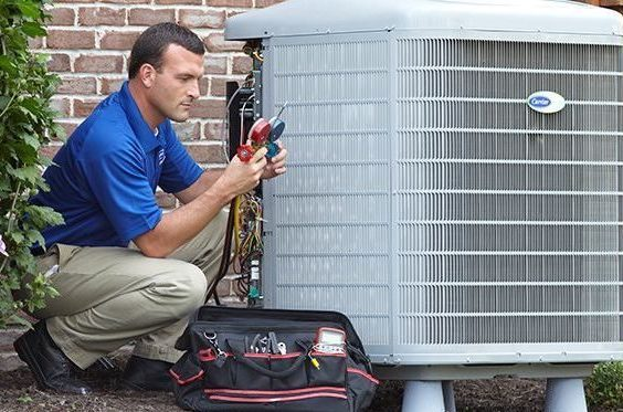 air conditioner repair service man working on a/c unit